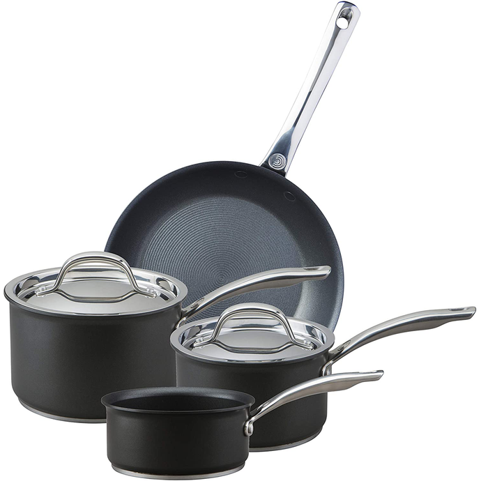 the four piece pan set featuring a milk pan, to saucepans with lids and a frying pan