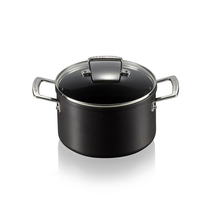 a casserole pot with a glass lid and stainless steel handles