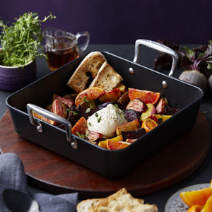 The roasting dish serving up beuratta, bread and fruit and vegetables