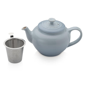 A blue tea pot with an internal chamber for loose leaf tea