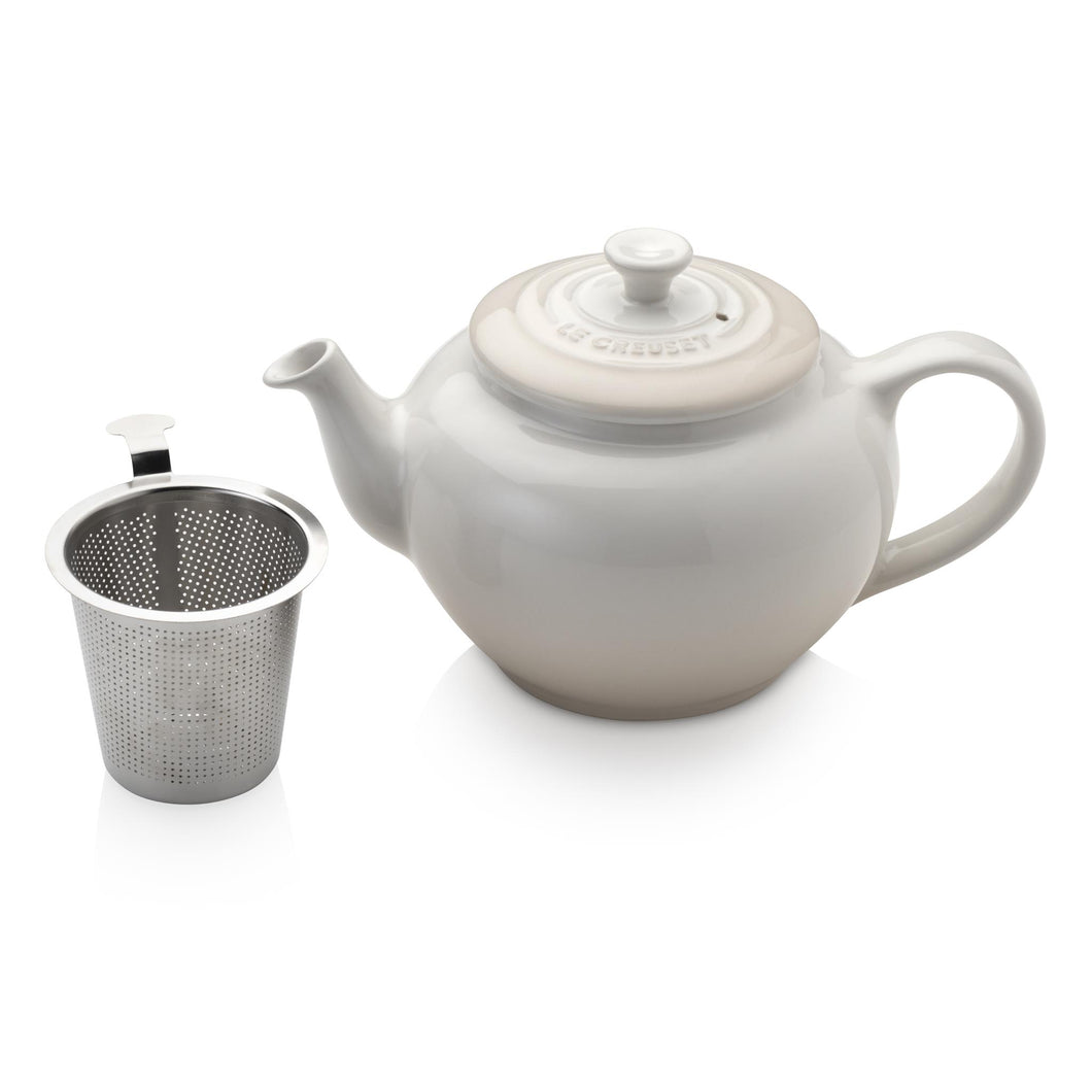 An off white tea pot with an internal chambe for loose leaf tea