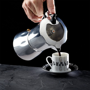 the espresso maker being used to pour coffee