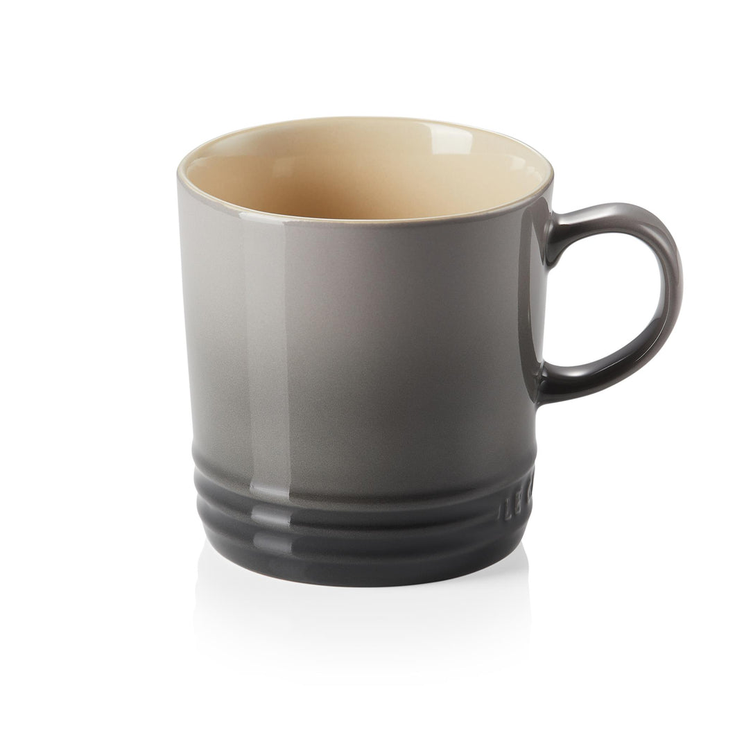 A black and grey ombre mug with a handle and beige interior