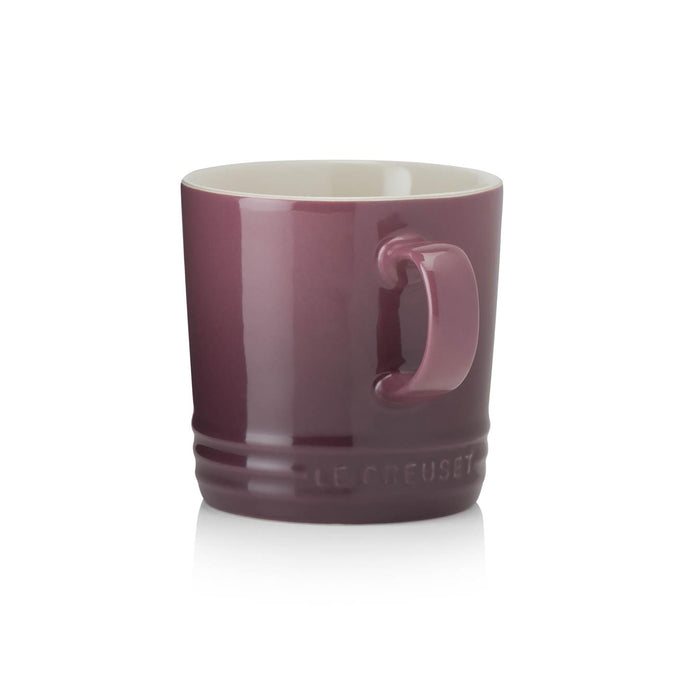 A purple ombre mug with a handle and beige interior