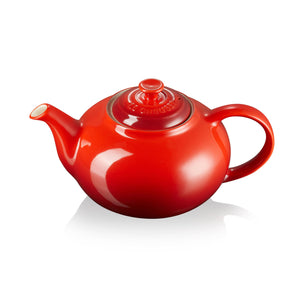 A classic red ombre tea pot with handle, lid and spout