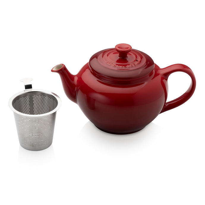 a red tea pot with an internal chamber for loose leaf tea