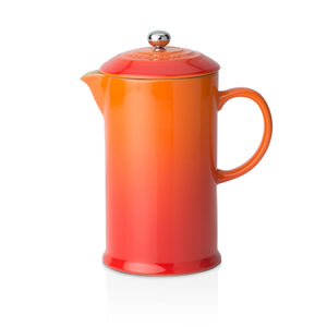 A red and orange ombre cafetiere with a stone wear handle and a lid with a stainless steel handle
