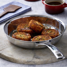 Load image into Gallery viewer, The pan displayed on a dining table serving up croquettes