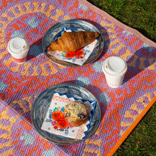 Load image into Gallery viewer, picnic on orange patterned outdoor rug