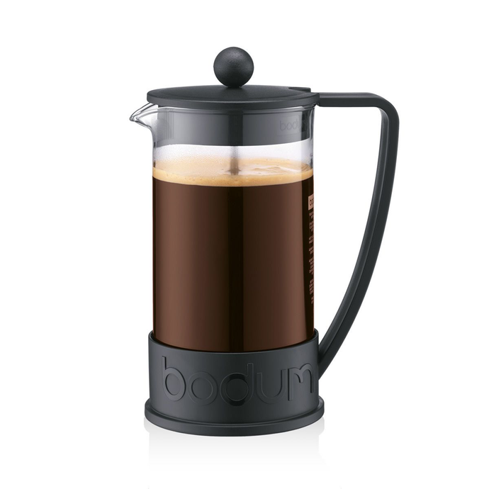 A borosilicate glass french press with a black plastic lid, handle and base