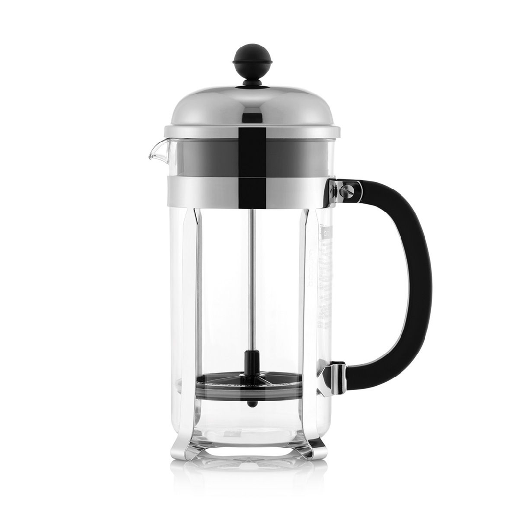 An empty  french press with a glass beaker, chrome hardware and a plastic handle