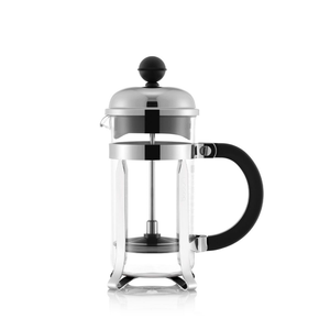 An empty small french press with a glass beaker, chrome hardware and a plastic handle