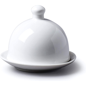 a white porcelian butter dish with a lid