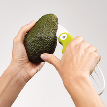 Load image into Gallery viewer, The GoAvocado Tool slicing open an avocado