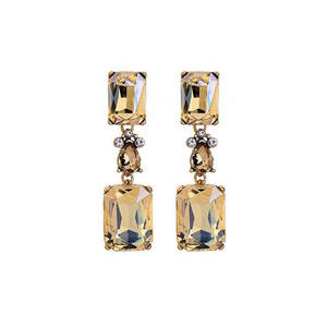 A pair of dangly earrings comprising of an amber rectangular gem, three mini clear gems surrounding a tear drop shaped amber gem followed by a second amber rectangular gem