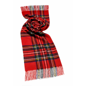 A tartan scarf with a royal stewart design and classic tassles