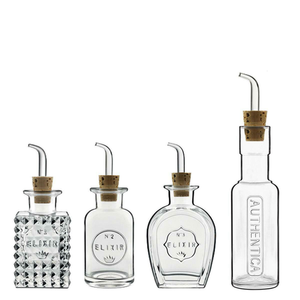 Four glass condiment bottles displayed in a row