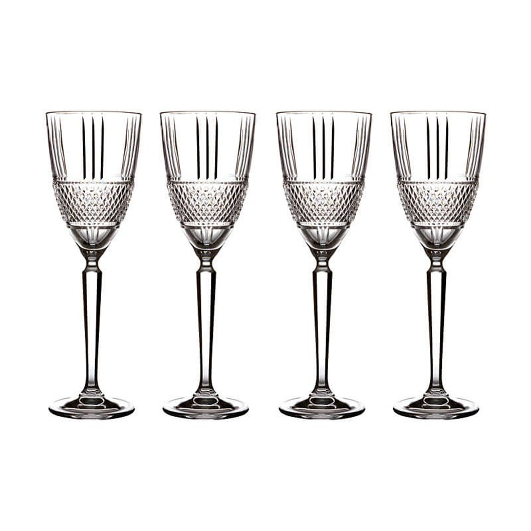 Four crystaline glasses in a row embossed diamond-cut band