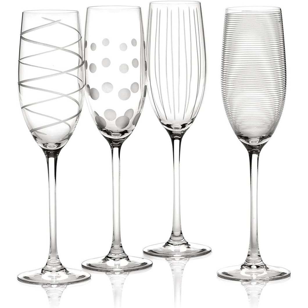 Four differently patterned champagne flutes