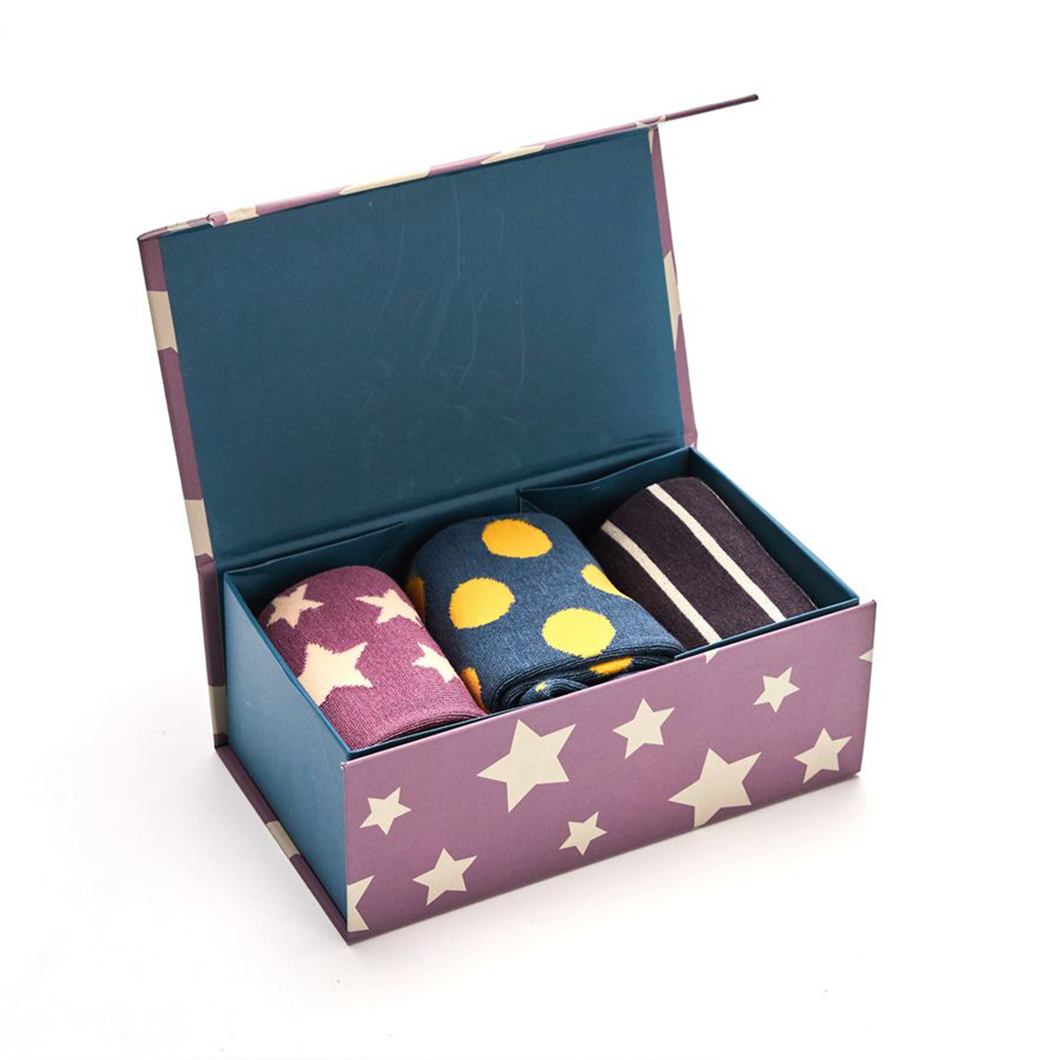 three pattern pairs of socks diplayed in a starry gift box
