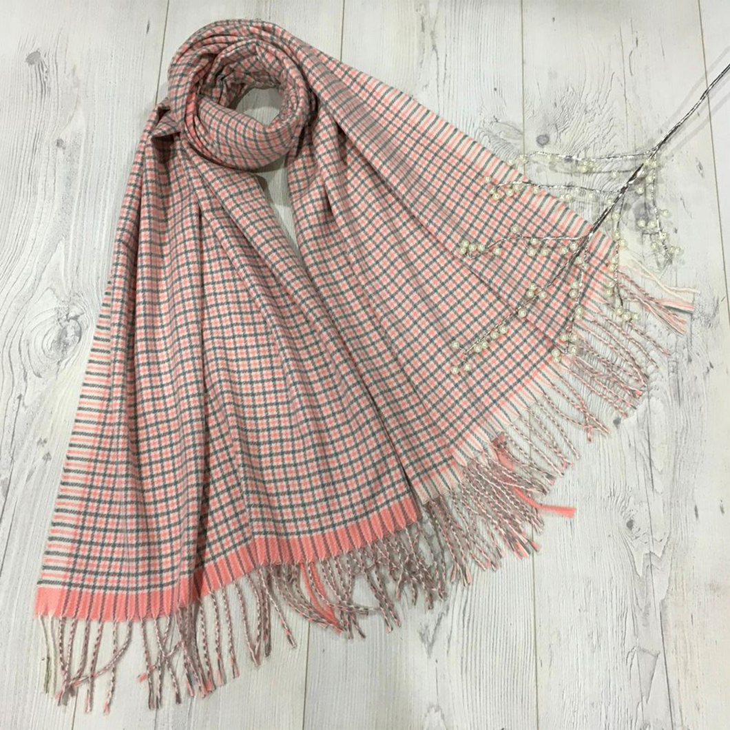 a cream coloured scarf with a pink and grey check pattern