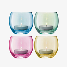 Load image into Gallery viewer, Four tealight holders with lit candles inside in blue, green, pink and yellow