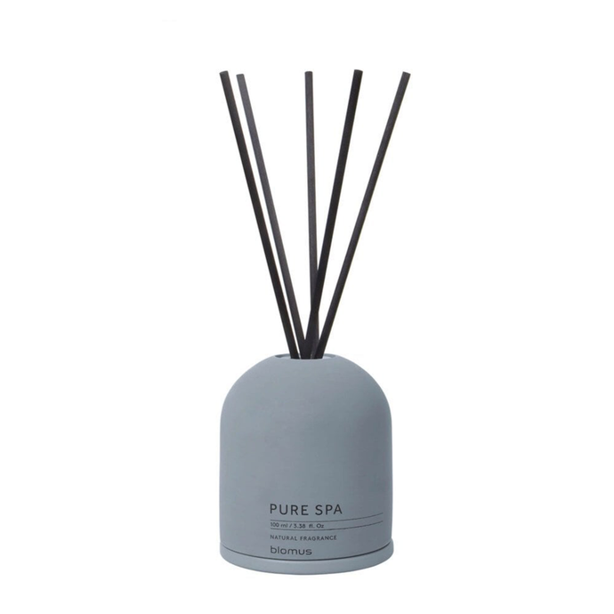 A rose & white musk scented reed diffuser with a concrete base