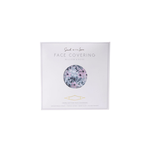 A cool grey coloured resuable face mask with a floral design  displayed in it's packaging