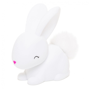 a small white bunny night light with a pink nose and fluffy tail