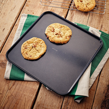 Load image into Gallery viewer, the baking sheet being used to serve up some cookies
