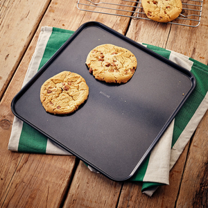 the baking sheet being used to serve up some cookies