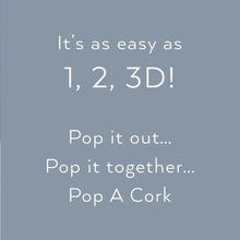 "Load image into Gallery viewer, ""It's as easy as 1, 2, 3D! Pop it out... Pop it together... Pop A Cork"""