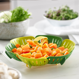 the basket being used to serve up steamed carrots and peas on a dining table