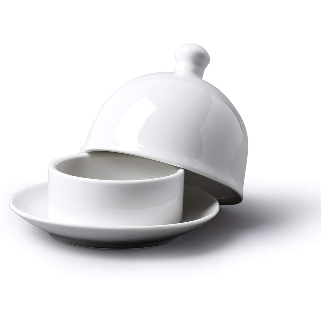 a white porcelain butter dish with a lid