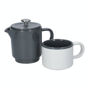 The french press and the mug sitting side by side