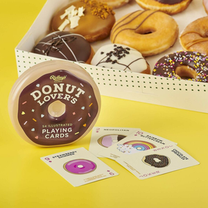 the donut tin with some cards in front of a box of donuts