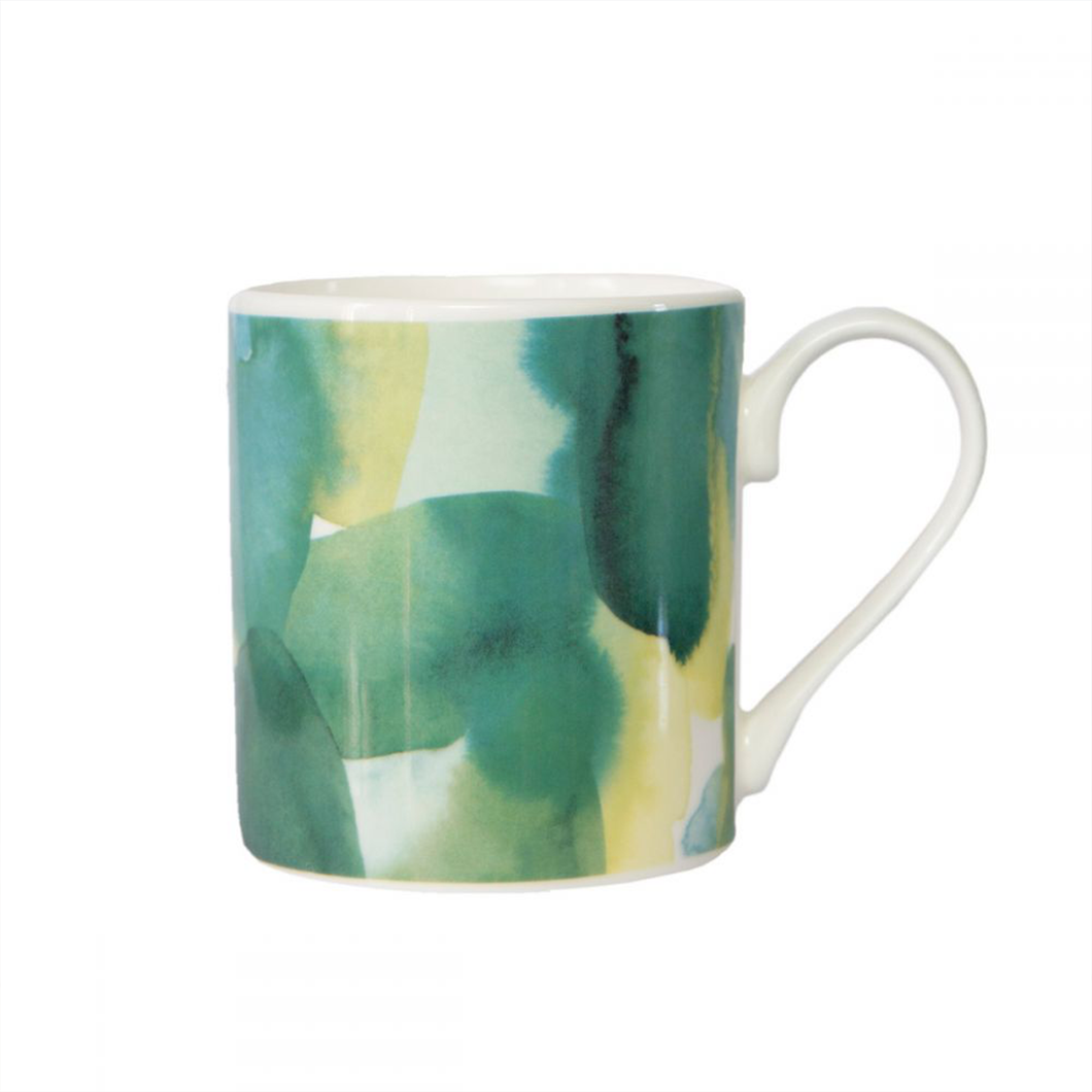 a bone china mug with a green watercolour pattern