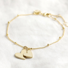 Load image into Gallery viewer, a chain braclet with small beads and two heart charms