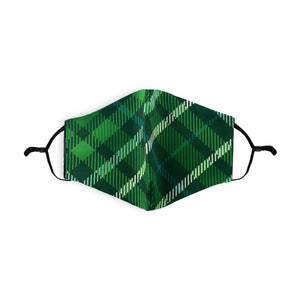 A face mask with a green tartan design