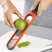 Load image into Gallery viewer, The Handi-Grate zesting a lime
