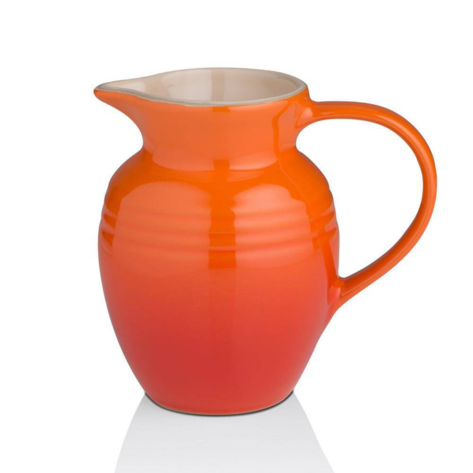 a vase shaped jug witha a large handle and a spout