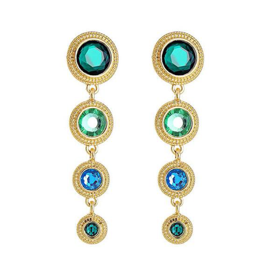 A pair of dangly earrings conprices of four gold discs, each with a green gem inlaid
