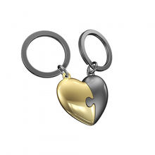 Load image into Gallery viewer, a pair of keyrings comprising of two halves of a heart that join together like a puzzle