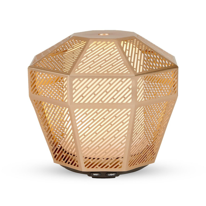 an aroma diffuser with a gold casing and internal ambient light