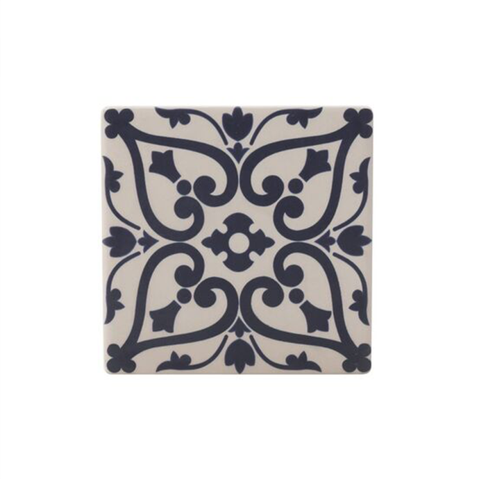 a tile inpsired coaster with a black and blush pink design