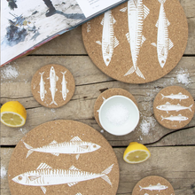 Load image into Gallery viewer, a flat lay shot of the coasters and placemats with some lemons, salt and a book