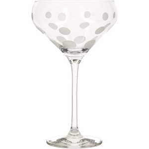 A champagne saucer with a spotted design