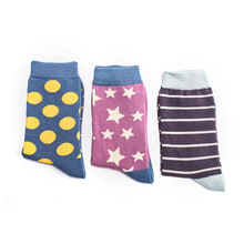 Load image into Gallery viewer, three pairs of socks - one with spots, one with stars and one with stripes