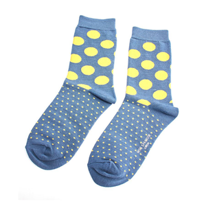 a blue and yellow spotted pair of socks