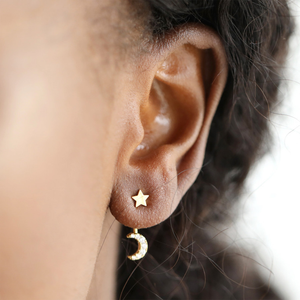 a woman modelling the star and moon earring